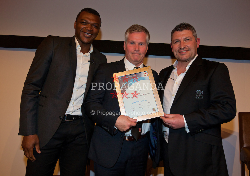 NEWPORT, WALES - Friday, May 20, 2016: Garreth Barker receives his Pro certificate from Marcel Desailly and Osian Roberts during the Football Association of Wales' National Coaches Conference 2016 at the Celtic Manor Resort. (Pic by David Rawcliffe/Propaganda)