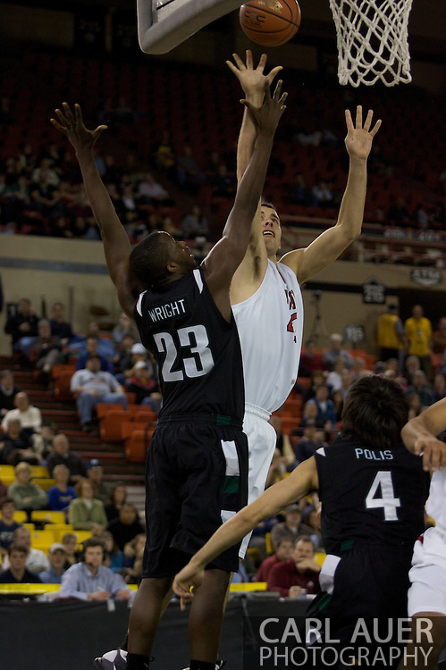 November 29th, 2008:  Anchorage, Alaska - Seattle University forward Austen Powers (42) shoots over Portland State guard/forward Wendell Wright (23) in the third place game on the final day of the Great Alaska Shootout.