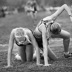 Suger-Salem High School runners Indya Price (left) and Shaylee Hill (right) collapse at the finish of the Girls 3A Idaho State Cross Country Championship held at Eagle Island State Park. Price finished in 6th place and Hill took 7th. Saturday November 1, 2014