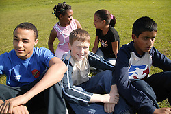 Multiracial group of children sitting in the park,