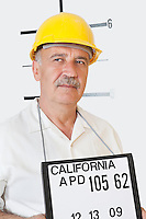 Mug shot of senior male constructor looking away