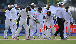 August 4, 2017 - Colombo, Sri Lanka - Sri Lankan players inspect an uneven spot on the pitch as Indian cricketer Ravindra Jadeja joins in during the 2nd Day's play in the 2nd Test match between Sri Lanka and India at the SSC international cricket stadium at the capital city of Colombo, Sri Lanka on Friday 04 August 2017. (Credit Image: © Tharaka Basnayaka/NurPhoto via ZUMA Press)