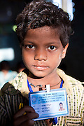 A young boy with his school identity card organised by CLAP, Committee for Legal Aid to Poor (CLAP) is a non-profit organisation helping to provide legal aid to the poorer communities in the Orissa district of India.