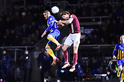 Shrewsbury Town striker (on loan from Norwich City) Carlton Morris (9) heads the ball  under pressure from Northampton Town defender Ash Taylor (6) during the EFL Sky Bet League 1 match between Northampton Town and Shrewsbury Town at Sixfields Stadium, Northampton, England on 20 March 2018. Picture by Dennis Goodwin.