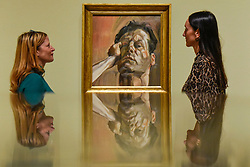 "© Licensed to London News Pictures. 23/10/2019. LONDON, UK. Staff members view ""Man's Head (Self-Portrait)"", 1963, by Lucien Freud. Preview of ""Lucian Freud: The Self-portraits"" at the Royal Academy of Arts in Piccadilly.  56 works on display chart Freud's artistic development over almost seven decades on canvas and paper in a show which runs 27 October to 26 January 2020.  Photo credit: Stephen Chung/LNP"