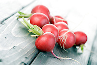 Studio shot of radish on wooden table