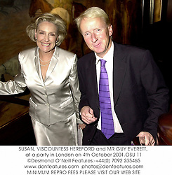 SUSAN, VISCOUNTESS HEREFORD and MR GUY EVERETT, at a party in London on 4th October 2001.	OSU 11