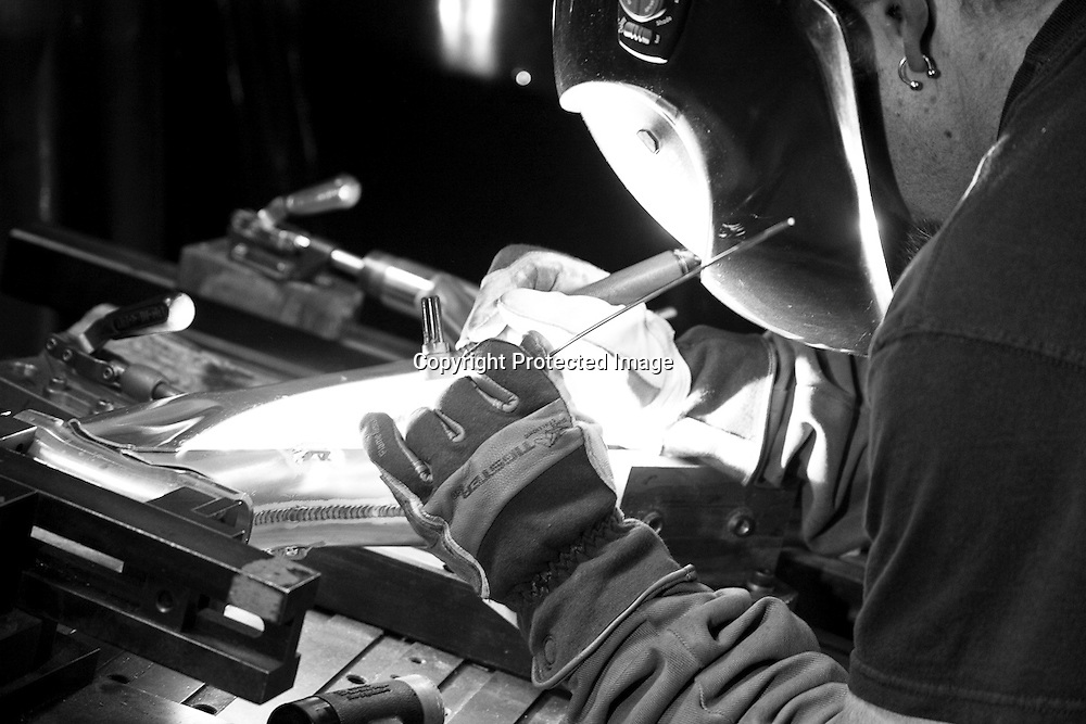 A precision TIG welder on the Intense Cycles 951 downhill mountain bike manufacturing line. He's welding aluminum mountain bike frames by hand in Intense's Temecula, California factory.