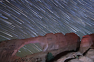 The stars apparent motion is captured behind the Skyline Arch in Arches National Park. A flashlight was used to illuminate the arch from below.<br /> <br /> Date Taken: 11/6/2013