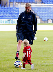 Liverpool manager Jurgen Klopp kicks a ball with a young fan - Mandatory by-line: Matt McNulty/JMP - 12/07/2017 - FOOTBALL - Prenton Park - Birkenhead, England - Tranmere Rovers v Liverpool - Pre-season friendly
