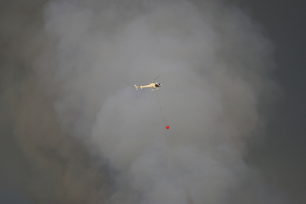 One of three helicopters at the fire burning near Awarua Wetlands, Invercargill, New Zealand, Monday, November 19, 2012. Credit:SNPA / Dianne Manson.