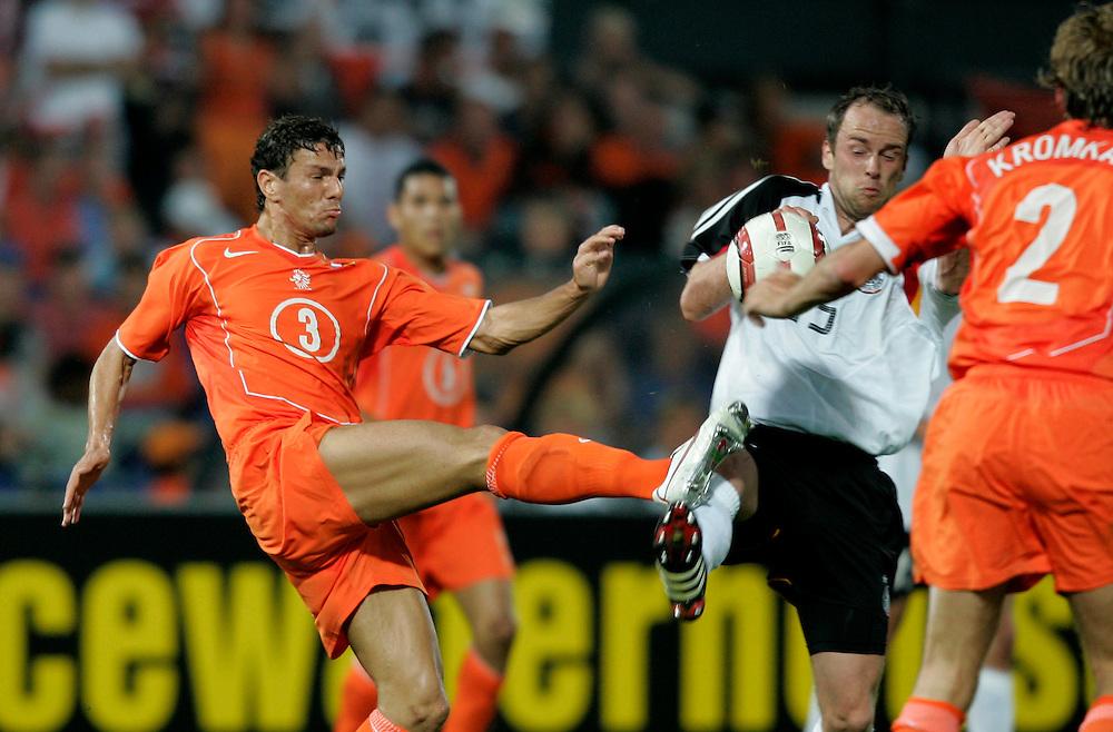 Holland. Rotterdam 17/08/05. Netherlands-Germany. Khalid Boulahrouz(L) and Fabian Ernst. Photo: Gerrit de Heus