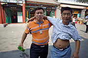 Panjiayuan weekend market. Two friends.