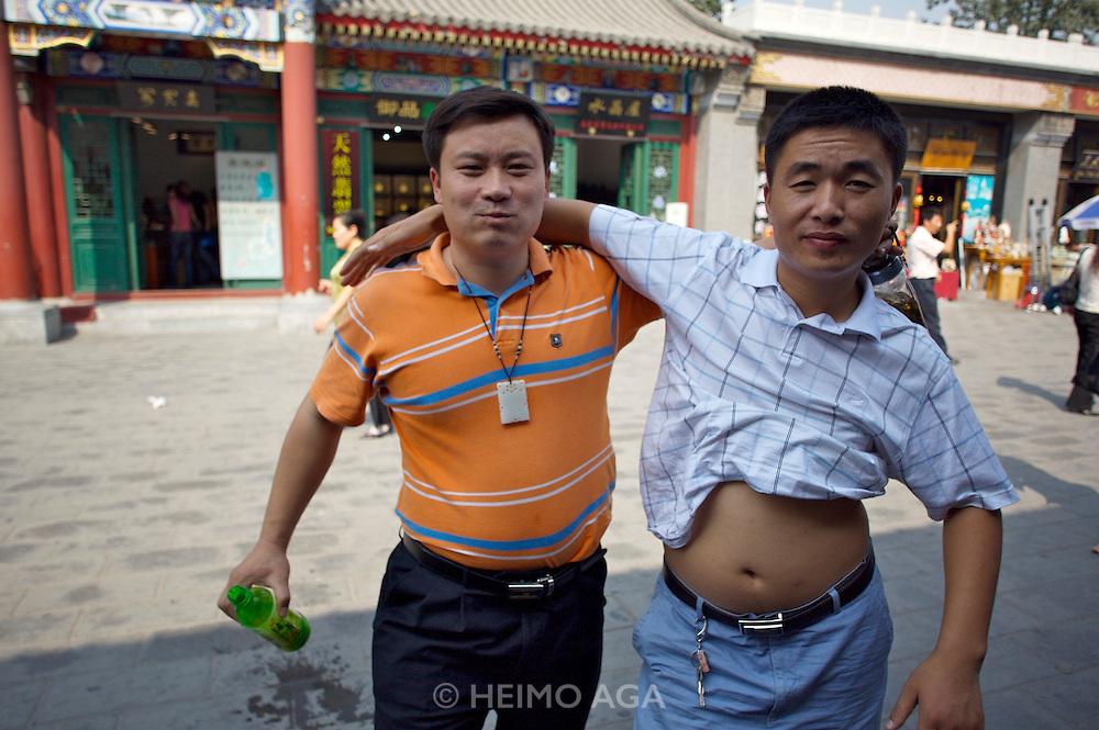 Panjiayuan weekend market. Two friends.