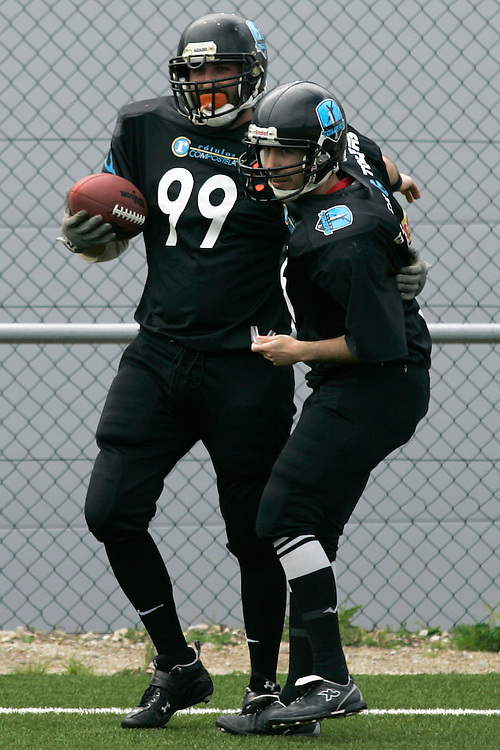 "(Santiago de Compostela, Spain - April 18, 2010) - The Galicia Black Towers beat the Oporto Lumberjacks 34-19 and clinch a playoff spot in their inaugural season. Quarterback David Siso threw five touchdown passes and connected with running back Pablo ""Mexi"" Benavent for three of them..Photo by Will Nunnally / Will Nunnally Photography"