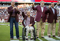 From left Texas A&M President Michael Young, Texas Governor Greg Abbott, Texas A&M Board of Regents member Charles Schwartz and Texas A&M Chancellor John Sharp wave to the crow before the start of an NCAA college football game between South Carolina and Texas A&M Saturday, Sept. 30, 2017, in College Station, Texas. (AP Photo/Sam Craft)