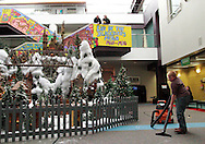 Andrew Roetting of Alexandria, Kentucky helps clean up excess snow as the Huntington Holiday Train display setup nears completion at the main branch of the Columbus Metropolitan Library in downtown Columbus, Sunday, November 25, 2012..The trains are setup by Applied Imagination on Saturday and Sunday and will run through mid-January.