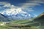 Alaska. Denali National Park. Visitors view Mt McKinley (20,320 ft) and the tundra near Stony  Wall.