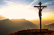 Jesus Christ crucifix in Alps