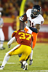 September 11, 2010; Los Angeles, CA, USA;  Virginia Cavaliers wide receiver Dontrelle Inman (81) is tackled by Southern California Trojans cornerback Nickell Robey (37) during the second quarter at the Los Angeles Memorial Coliseum.
