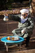TALIOUINE, MOROCCO - October 25th 2015 - Amazigh Moroccan man prepares saffron tea with freshly harvested stigmas at a saffron farm in Taliouine, Sirwa Mountain Range, Souss Massa Draa, Southern Morocco