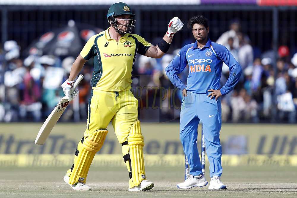 Aaron Finch of Australia celebrates his Hundred runs  during the 3rd One Day International between India and Australia held at the Holkar Stadium in Indore on the 24th  September 2017<br /> <br /> Photo by Arjun Singh / BCCI / SPORTZPICS