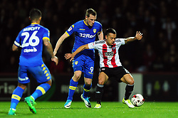 Nico Yennaris of Brentford competes with Chris Wood of Leeds United - Mandatory by-line: Patrick Khachfe/JMP - 04/04/17 - FOOTBALL - Griffin Park - Brentford, London - Brentford v Leeds United - Sky Bet EFL Championship