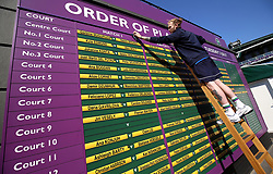 Ground staff update the order of play board on day two of the Wimbledon Championships at the All England Lawn Tennis and Croquet Club, Wimbledon.