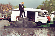 Two male travellers, walking up ramp to their van in the floodwater, Dresden, Germany, 2000's,