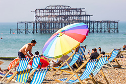 © Licensed to London News Pictures. 24/08/2019. Brighton, UK. Members of the pubic take to the beach and seafront in Brighton and Hove on the August Bank Holiday Saturday as hot and sunny weather is hitting the seaside resort. Photo credit: Hugo Michiels/LNP