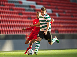 LIVERPOOL, ENGLAND - Wednesday, August 17, 2011: Liverpool's Toni Brito De Silva in action against Sporting Clube de Portugal's Michael Pinto during the first NextGen Series Group 2 match at Anfield. (Pic by David Rawcliffe/Propaganda)