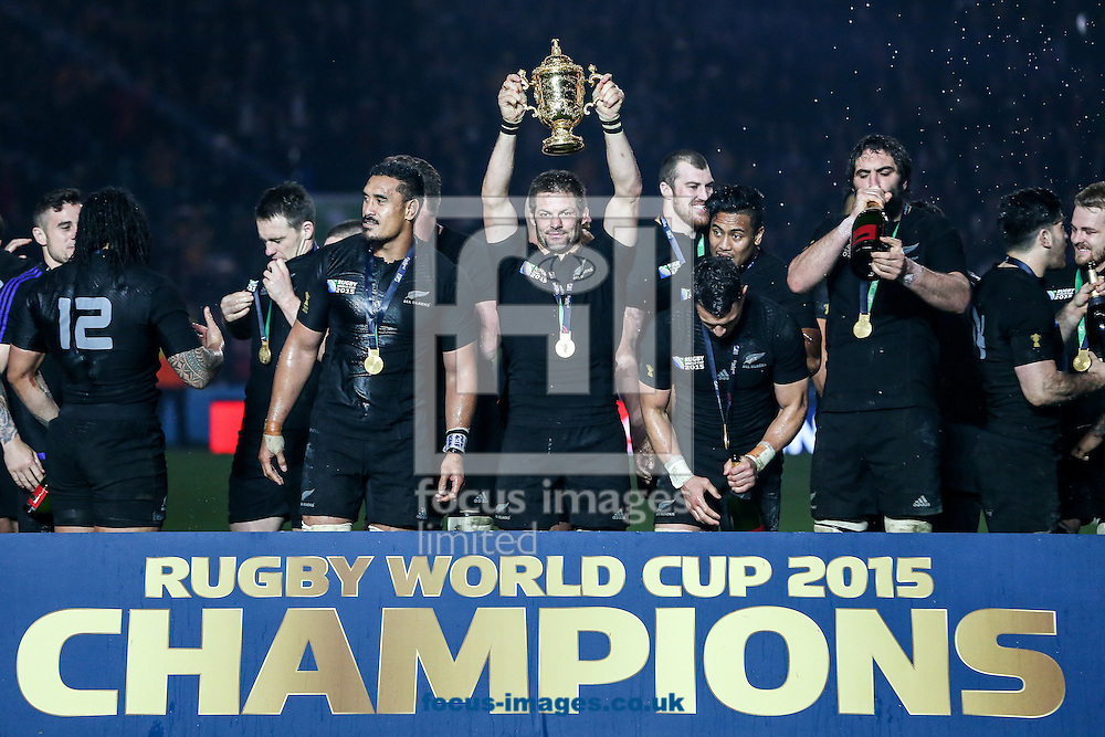 Richie McCaw of New Zealand (centre) holds aloft the Rugby World Cup trophy after the final of the 2015 Rugby World Cup at Twickenham Stadium, Twickenham<br /> Picture by Andy Kearns/Focus Images Ltd 0781 864 4264<br /> 31/10/2015