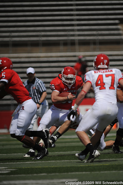 Apr 18, 2009; Piscataway, NJ, USA; Rutgers RB Joe Martinek (38) runs through blocks towards LB Patrick Kivlehan (47) during the first half of Rutgers' Scarlet and White spring football scrimmage.