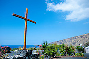 A large wooden crucifix in the parking lot of a church by Kealakekua Bay on the Big Island of Hawaii.
