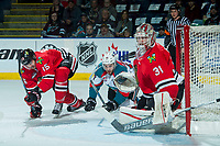KELOWNA, CANADA - APRIL 8: Rodney Southam #17 of the Kelowna Rockets is checked to the ice by Shaun Dosanjh #15 in front of the net of Cole Kehler #31 of the Portland Winterhawks on April 8, 2017 at Prospera Place in Kelowna, British Columbia, Canada.  (Photo by Marissa Baecker/Shoot the Breeze)  *** Local Caption ***