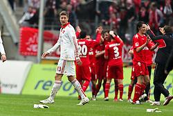 03.04.2010,  Rhein Energie Stadion, Koeln, GER, 1.FBL, FC Koeln vs 1. FC Nuernberg, 28. Spieltag, im Bild: Im Hintergrund feiert der FC das 1:0. Jens Hegeler (Nuernberg #13) ist entaeuscht / entäuscht.  Auf dem Boden liegen die Handschuhe von Nürnbergs Torwart Schaefer  EXPA Pictures © 2011, PhotoCredit: EXPA/ nph/  Mueller       ****** out of GER / SWE / CRO  / BEL ******