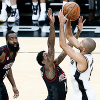01 May 2017: San Antonio Spurs guard Tony Parker (9) takes a jump shot over Houston Rockets guard Lou Williams (12) and Houston Rockets guard James Harden (13) during the Houston Rockets 126-99 victory over the San Antonio Spurs, in game 1 of the Western Conference Semi Finals, at the AT&T Center, San Antonio, Texas, USA.