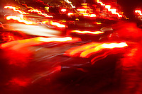 Combined in camera effects merge to create a red hot image of choas of red streaks and lines. The original image is of cars at night on a wet road. No Photoshop manipulations - except for exposure and saturation - were used to create this image.