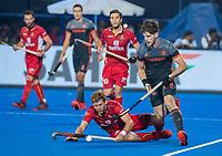 BHUBANESWAR, INDIA - Lars Balk (Ned) met Gauthier Boccard (Belgie)     tijdens de  finale tussen België en Nederland bij het WK Hockey heren in het Kalinga Stadion. COPYRIGHT KOEN SUYK
