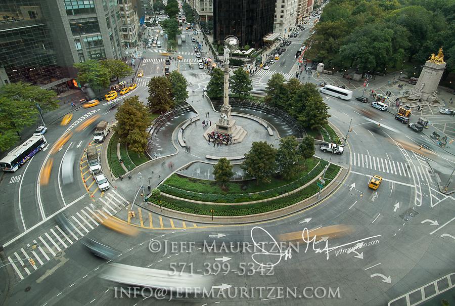 Traffic drives through Columbus Circle in midtown Manhattan, NYC.