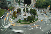 Traffic drives through Columbus Circle in midtown Manhattan, NYC.