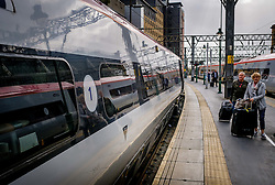 First class passengers alighting from a Virgin express passenger train at Glasgow Central Station from London Euston<br /> <br /> (c) Andrew Wilson | Edinburgh Elite media