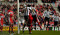 Photo: Jed Wee.<br /> Middlesbrough v Newcastle United. The Barclays Premiership. 09/04/2006.<br /> <br /> Newcastle's Lee Bowyer (L) and Titus Bramble pounce on confusion at the near post to score the opening goal.