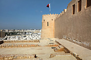 Crenellated ramparts and corner tower of the Sheikh Salman bin Ahmed Al-Fateh Fort, or Riffa Fort, built in the 17th century and rebuilt as the ruling Al Khalifa family home in 1812, at Riffa, Bahrain. The fort is square with 2 circular and 2 rectangular towers at its corners, and 3 courtyards. It was restored in the 20th century and is now a tourist attraction. Picture by Manuel Cohen