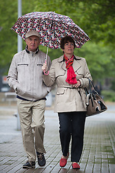 © Licensed to London News Pictures. 14/05/2015. Bristol, UK. A couple sharing an umbrella whilst braving the wet weather in Bristol city centre today, Thursday 14th May 2015. Photo credit : Rob Arnold/LNP