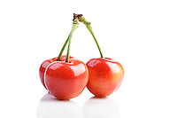 Studio shot of cherries on white background