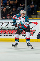 KELOWNA, CANADA - DECEMBER 29: Kyle Topping #24 of the Kelowna Rockets skates with the puck and looks for the pass against the Kamloops Blazers  on December 29, 2018 at Prospera Place in Kelowna, British Columbia, Canada.  (Photo by Marissa Baecker/Shoot the Breeze)