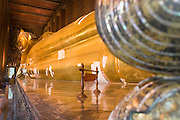 29 FEBRUARY 2008 -- BANGKOK, THAILAND: The large reclining Buddha in Wat Po is the temple's most famous feature. Wat Phra Chetuphon, which is more commonly known by its old name of Wat Po is both the largest and older Buddhist Temple in Bangkok. It  was founded in the 17th century and covers about 20 acres.   Photo by Jack Kurtz