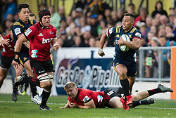 Highlanders' Tevita Li, right, makes a run against the Crusaders in the Super Rugby match, Forsyth Barr Stadium, Dunedin, New Zealand, Saturday, March 17, 2018. Credit:SNPA / Adam Binns ** NO ARCHIVING**