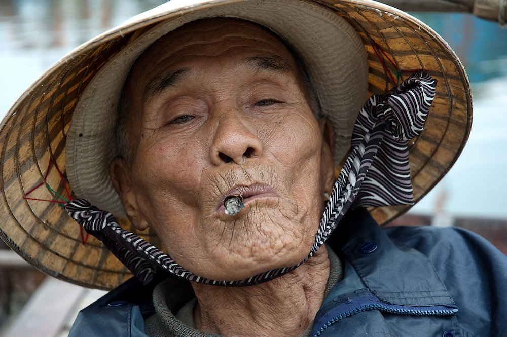 Funny Vietnamese Fisherman With Golden Tooth And Cigar Cigarette